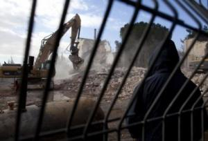 Israeli bulldozers demolish a hotel in East Jerusalem in January Source: Getty Images