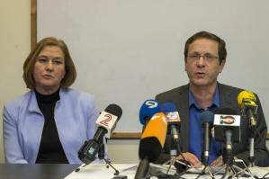 Israeli co-leaders of the Zionist Union party, Labour Party's leader Isaac Herzog (R) and MP and HaTnuah party's leader Tzipi Livni give a joint press conference at the party headquarters in the Israeli coastal city of Tel Aviv on March 18, 2015 a day after the country's general election. After a closely-fought campaign, Israeli Prime Minister Benjamin Netanyahu's rightwing Likud party confounded the polls to win 30 of the 120 seats in parliament against 24 for rivals the centre-left Zionist Union. AFP PHOTO / JACK GUEZ