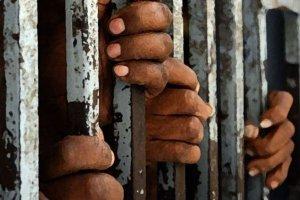 prison-jail-hands-bar