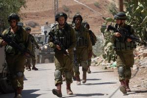 2014_9_4-israeli-military-patrol-the-streets-during-a-military-operation-at-al-nassariya-1